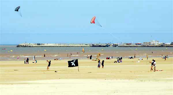 The beach of Essaouira a summerday. Kitesurfing
