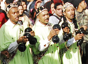Gnaouas playing their  qarqbas