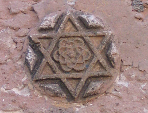 Jewish star with a rose in the middle