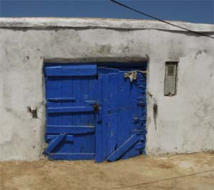 A blue painted door in the port
