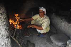 Woman at rural oven
