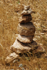 Stone pillar at the road side